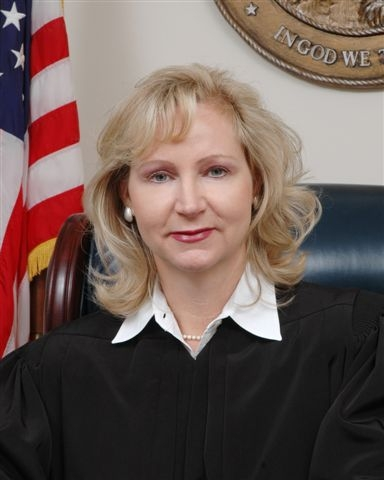 Photo of the Honorable: Morgan Laur Reinman. Opens in new window.